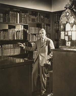 WIlmarth Lewis standing in his library