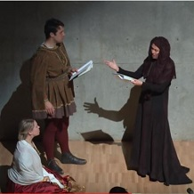 three adults in costume with scripts