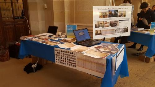 color photo of table and display with photos of archival materials