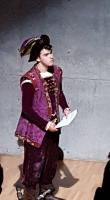 Young man in elaborate purple costume