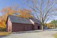 Color photo of the barns at the LWL, autumnal trees behind