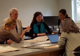 Curators and scholars consult on exhibition prints